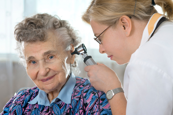 A Hearing Specialist Doing Ear Inspection for an Old Lady