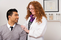 Female doctor with a male patient