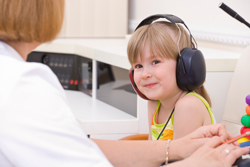 Female Audiologist Testing A Young Girls Hearing