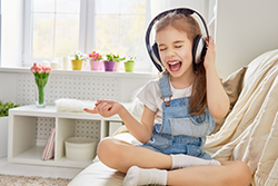 Girl Listening To Loud Music